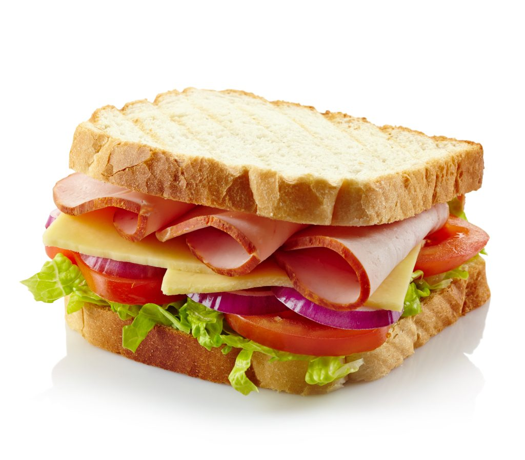 Sandwich with ham, cheese and fresh vegetables isolated on white background